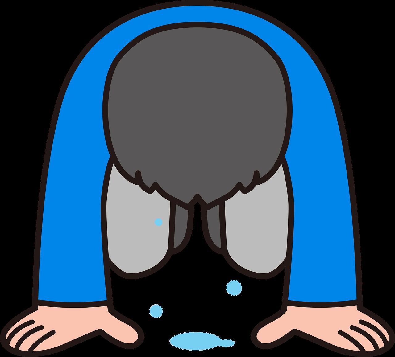 涙を流し土下座する人